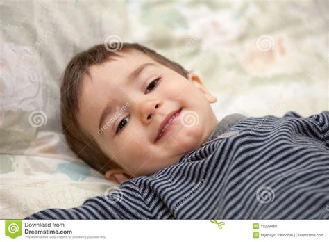 lay on the bed boy lay on a bed stock photo image 19229460