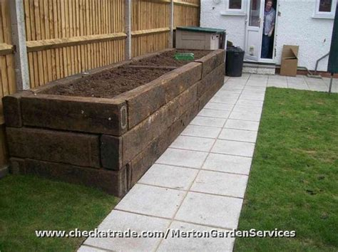Railway Sleeper Garden Bed by Rubbish Cleared Fences Replaced Path Laid Raised Beds