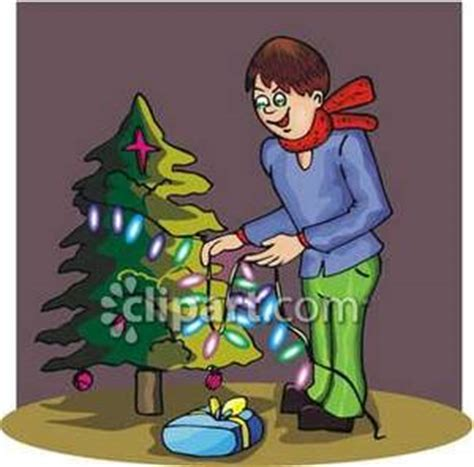 stringing lights on a tree royalty free