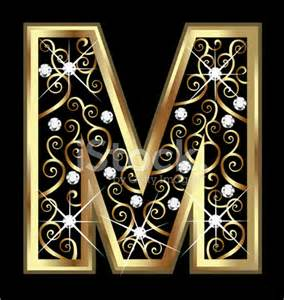 gold letter m with swirly ornaments stock photos
