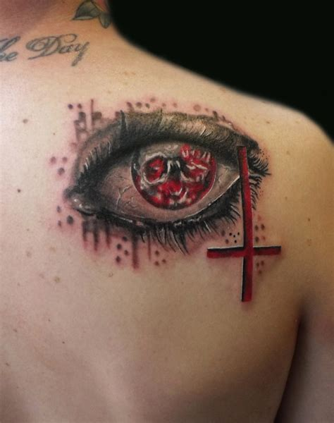 cross tattoo by eye 51 evil eye tattoos