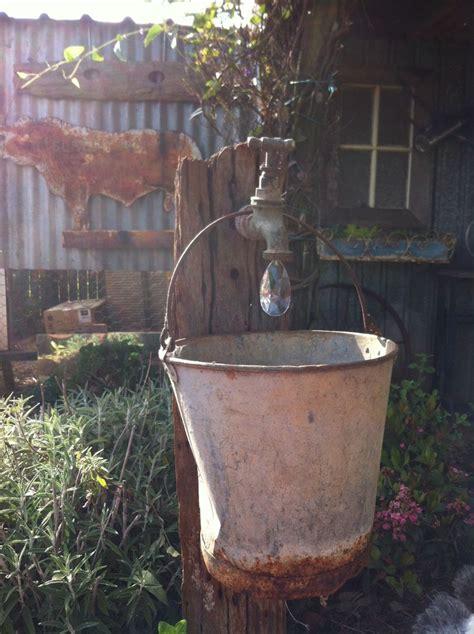toowoomba australia garden art rusty bucket garden