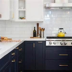 navy blue kitchen cabinets navy blue kitchen cabinets with brushed brass pulls and