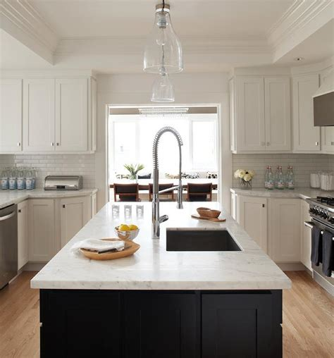 black kitchen island white marble countertop design ideas