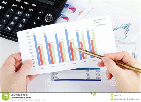 Business Table by Graphs Charts Business Table Royalty Free Stock Image