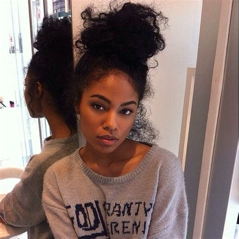 pics of black women pretty big hair buns with added hair buns top bun and curly bun on pinterest
