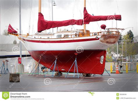 sailboat upkeep cost colorful sailboat in dry dock royalty free stock photo