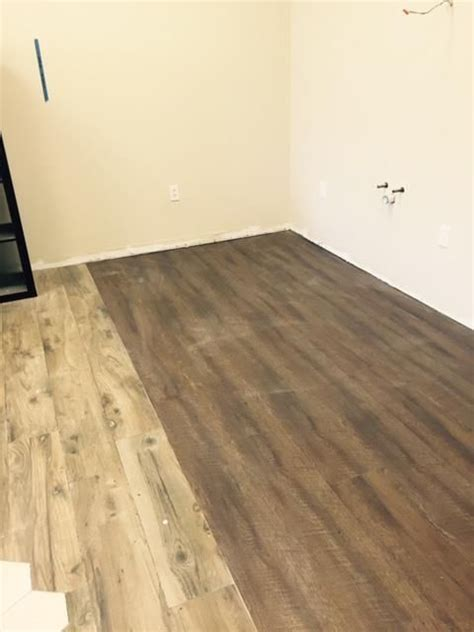 beautiful coretec plus xl 9in plank venice oak its laid next to wood planks and looks more