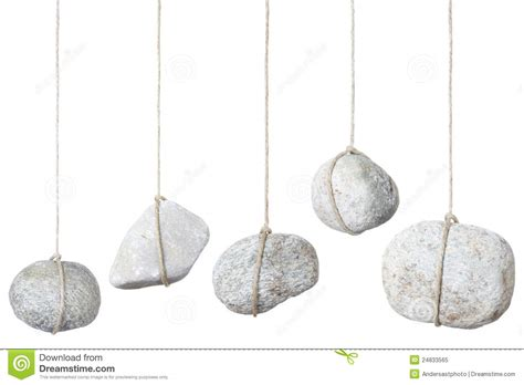 stone rock hanging by a string royalty free stock photo