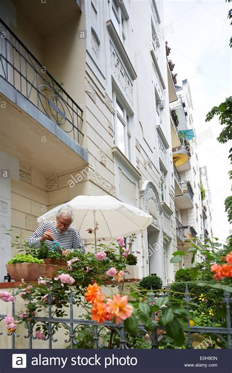 flowerbox deutschland resident of the isestrasse replanting his flower box