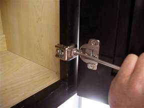 How To Adjust Hinges On Kitchen Cabinets How To Install And Level Cabinet Doors How Tos Diy