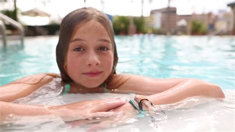 young little 14 preeteen boys pre teen girl going underwater in the pool stock footage
