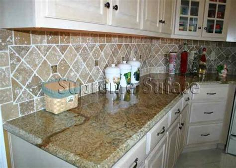 granite tile backsplash on granite countertops