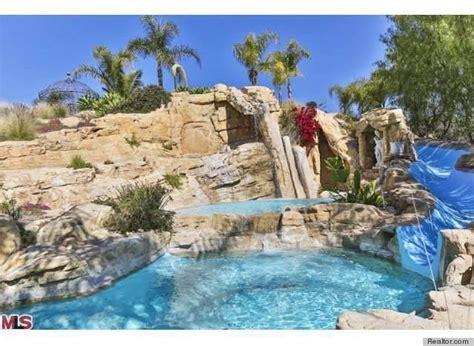 backyard pool water slide 6 epic water slides that make a lavish swimming pool even better photos huffpost
