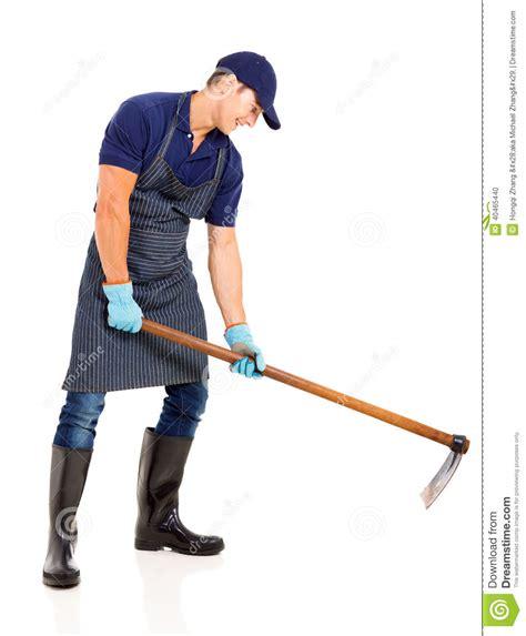 How To Hoe A Garden by Gardener Working Hoe