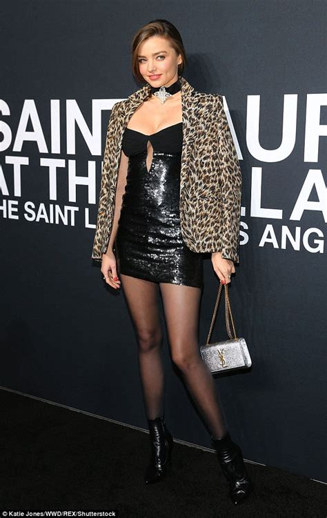 miranda kerr shows off her wild side at saint laurent fashion show in la daily mail online