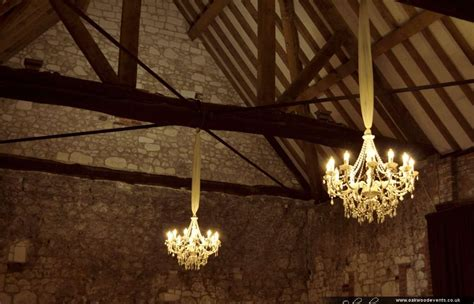 Barn Chandeliers white chandeliers for a barn wedding