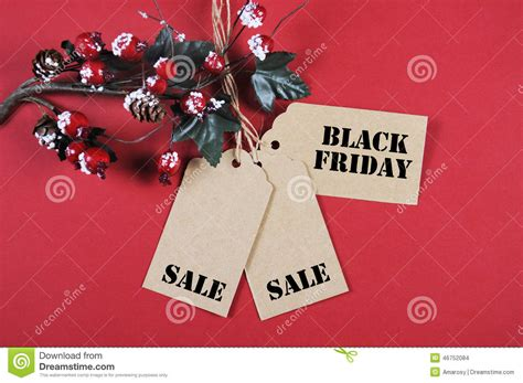 black friday sale tags with christmas decorations stock