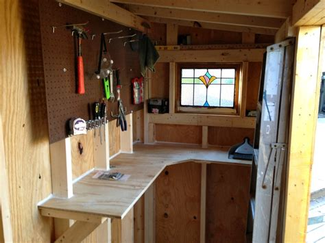 Shed Workbench Ideas sturdy workbench and peg board to maximize small shed organization space shed ideas