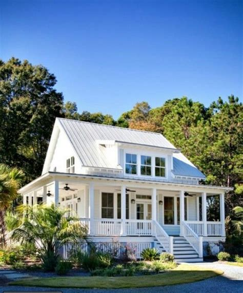 Lowcountry House Plans by Simple White Cottage With Wrap Around Porch Exterior