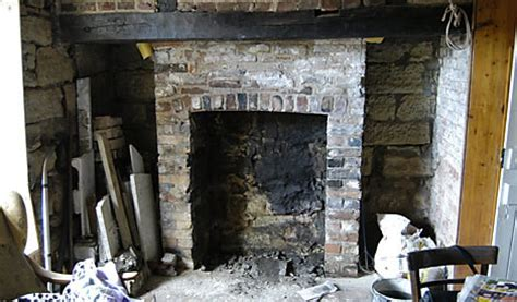 how to rebuild a fireplace opening up a fireplace