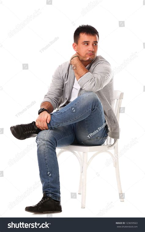 Sitting On The by Caucasian Handsome Sitting On The Chair Isolated