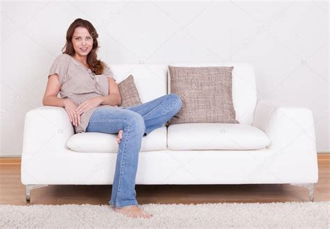 Sit On Sofa by Casual Sitting On A Stock Photo 169 Andreypopov 12778059