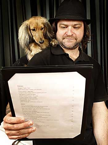 masterchef's chris badenoch holds a dinner for stray dogs