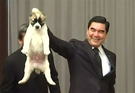 putin puppy the moment vladimir putin kissed a puppy given to him by turkmenistan s president