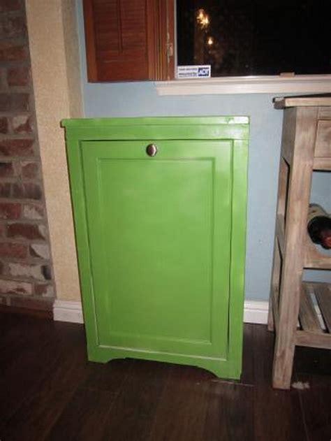 tilt out trash cabinet hide your trash bin by building a tilt out trash cabinet