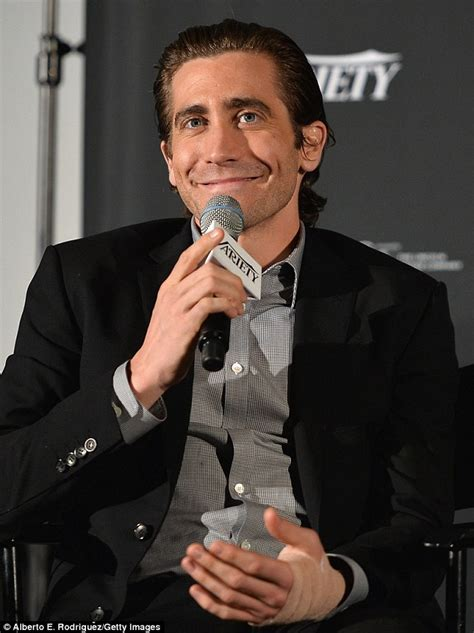 grinning jake gyllenhaal displays bandaged hand at