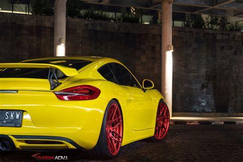 porsche cayman yellow yellow cayman s looking jaunty on matte red custom wheels