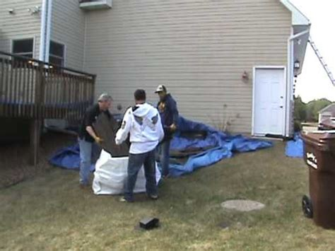 load shingles to roof loading a load a bag with roofing shingles on the ground