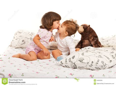 girls kissing in bed first kiss royalty free stock image image 34063536