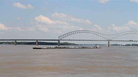 tugboat goes under bridge pan of the highway 49 bridge over the mississippi river