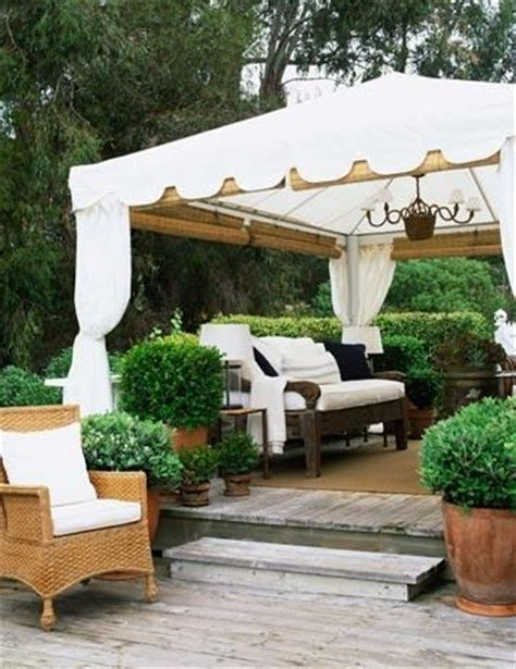 Outdoor Bamboo Rugs For Patios Garden Room A White Tent With Roll Up Bamboo Shades And A Sisal Rug Make This Outdoor Space