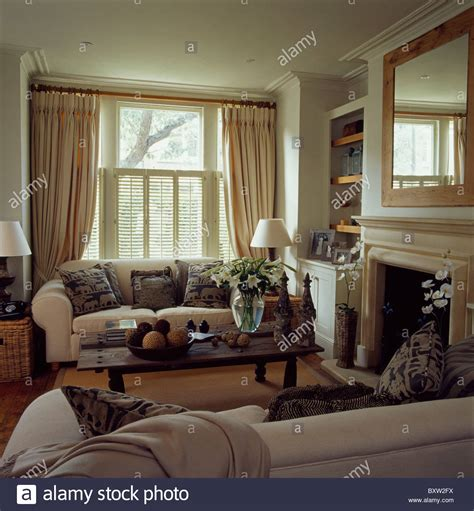 townhouse living room cream sofas in townhouse living room with cream curtains