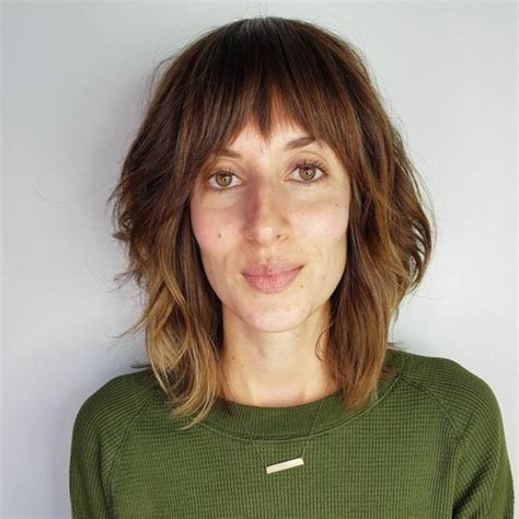 women s layered brunette a line lob with fringe bangs and highlights women s layered brunette a line lob with fringe bangs and