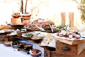 a rustic canap 233 table with wooden boards of charcuterie