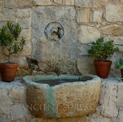 wall fountains out of antique limestone mediterranean