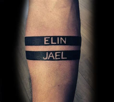 tattoo name band designs man with negative space black ink armband name tattoo
