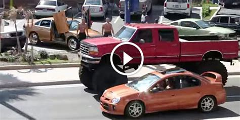 check   incredibly tall lifted ford truck driving