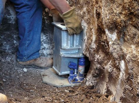 How To Fix Sinking Foundation installing push piers for foundation stabilization in portland eugene olympia or and wa
