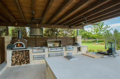 Maken S Kitchen Open 24h gourmet outdoor kitchen with pizza oven and flat screen tv