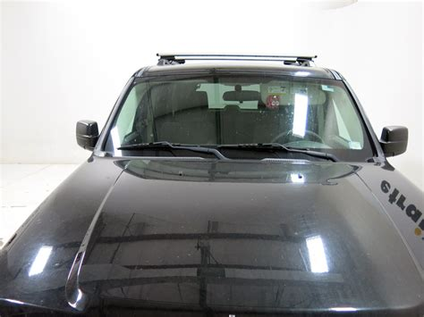 roof rack for jeep liberty thule roof rack for 2012 liberty by jeep etrailer