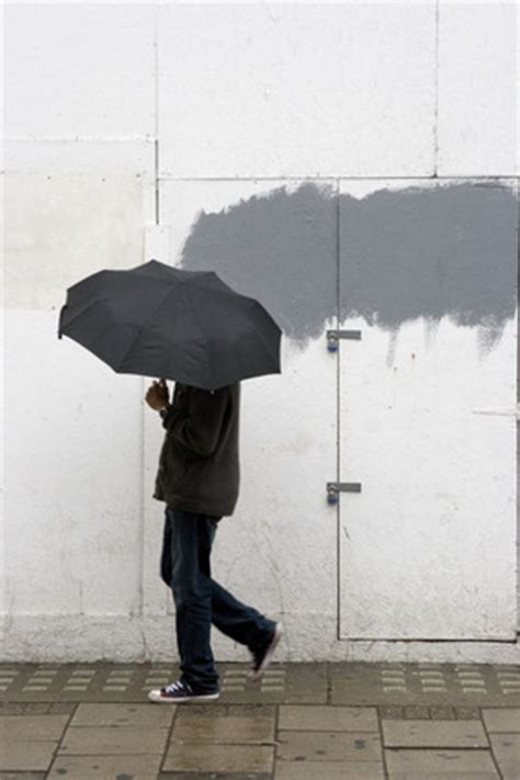 a man walking with umbrella in new oxford street; 2008 by