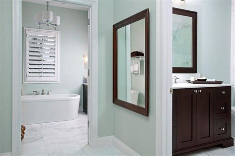 i the light aqua walls and wood in this bathroom paint