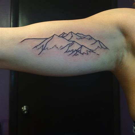 evan davis tattoo mountains done by evan davis
