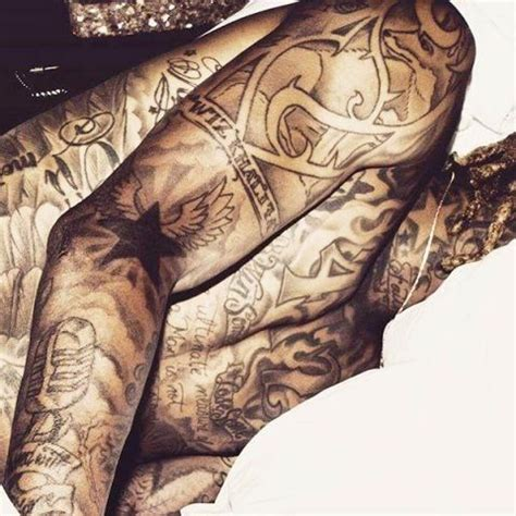 wiz tattoos wiz khalifa s 9 tattoos their meanings guru