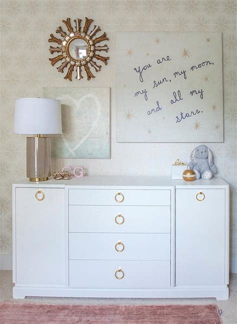 white nursery dresser with gold ring pulls transitional